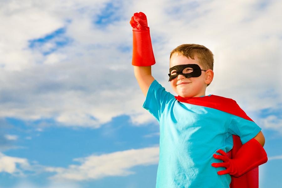 Child pretending to be superhero